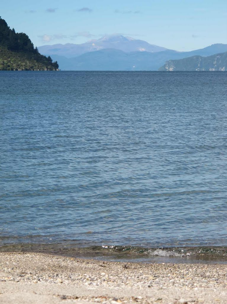 Tongariro Mtns seen across Lake Taupo from beach